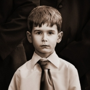 sentimental vintage look photo of a ring bearer at the Davis Island Garden Club in Tampa, FL